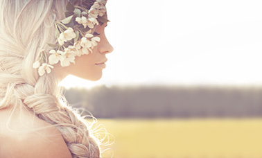 blonde braid hair upstyling with flowers for women