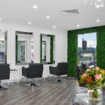 Kelly Elle Salon interior black chairs and mirrors